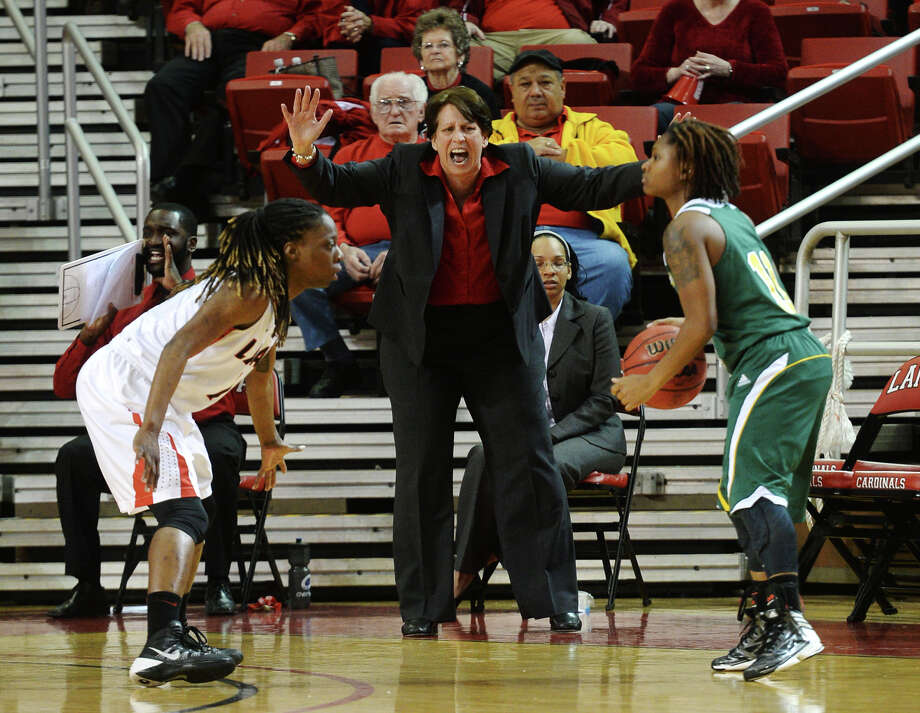 Lamar Coach Robin Harmony, center, yells from the sidelines while Lamar's Gia Ayers, No. 1, left, and Southeastern Louisiana's Elizabeth Styles, No. 11, square off Saturday afternoon. Lamar University played against Southeastern Louisiana at the Montagne Center on Saturday. Photo taken Saturday, 3/8/14 Jake Daniels/@JakeD_in_SETX Photo: Jake Daniels / ©2014 The Beaumont Enterprise/Jake Daniels