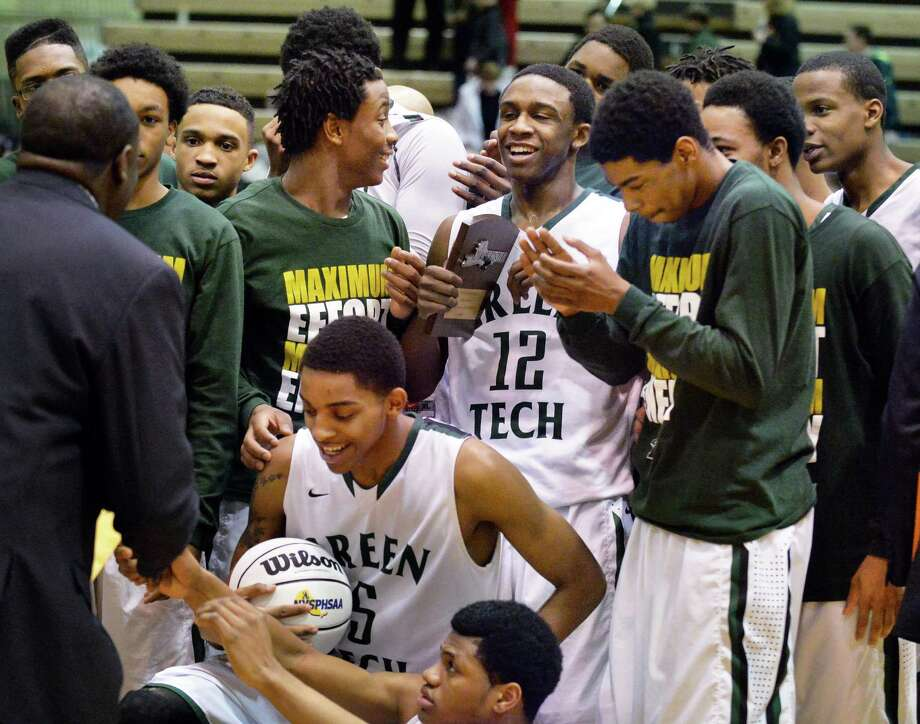 Green Tech head coach Jamil Hood, Sr. and players celebrate their victory in the Class AA boys' regional final against Proctor Saturday March 8, 2014, in Troy, NY.  (John Carl D'Annibale / Times Union) Photo: John Carl D'Annibale / 00026033A