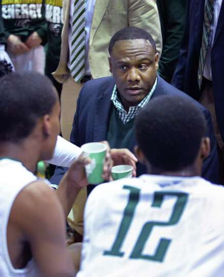 Green Tech head coach Jamil Hood, Sr. with players during the Class AA boys' regional final against