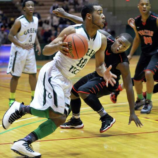Green Tech's #10, DeSean Mack, left, drives past Proctor's #21 J'Von Evans during the Class AA boys'