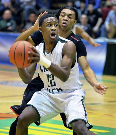 Green Tech's #12 Jamil Hood, Jr., left and Proctor's #22 Denvil Brown during the Class AA boys' regi