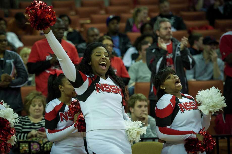 Galena Park North Shore cheerleaders cheer as their team takes the court for the first half of the boys' UIL Class 5A state basketball championship game on Saturday, March 8, 2014, in Austin. Smiley N. Pool / Houston Chronicle ) Photo: Smiley N. Pool, Houston Chronicle / © 2014  Houston Chronicle