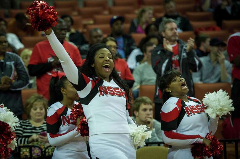 Galena Park North Shore cheerleaders cheer as their team takes the court for the first half of the b