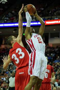 Galena Park North Shore's Jarrey Foster (25) goes up for a shot as Converse Judson forward David Wacker Photo: Smiley N. Pool, Houston Chronicle / © 2014  Houston Chronicle