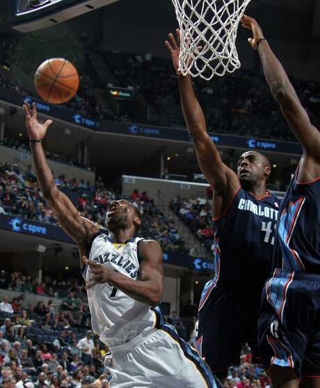 Grizzlies guard Tony Allen, who had eight points, six rebounds and four assists, gets off a shot despite the efforts of the Bobcats' Anthony Tolliver. Photo: Nikki Boertman / Memphis Commercial Appeal / The Commercial Appeal