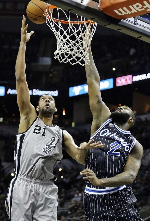 San Antonio Spurs' Tim Duncan shoots around Orlando Magic's Kyle O'Quinn during second half action Saturday March 8, 2014 at the AT&T Center. The Spurs won 121-112. Photo: San Antonio Express-News