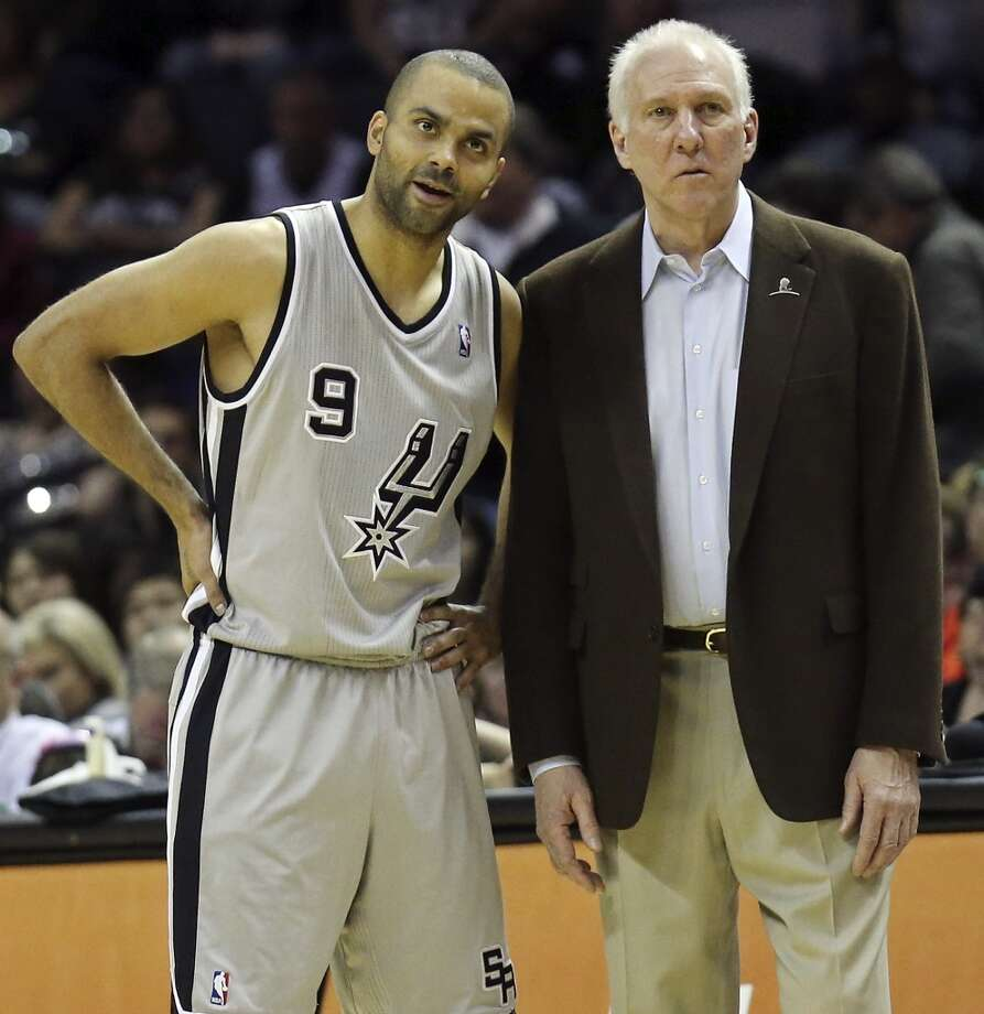 San Antonio Spurs' Tony Parker talks with coach Gregg Popovich during second half action Saturday March 8, 2014 at the AT&T Center. The Spurs won 121-112. Photo: San Antonio Express-News