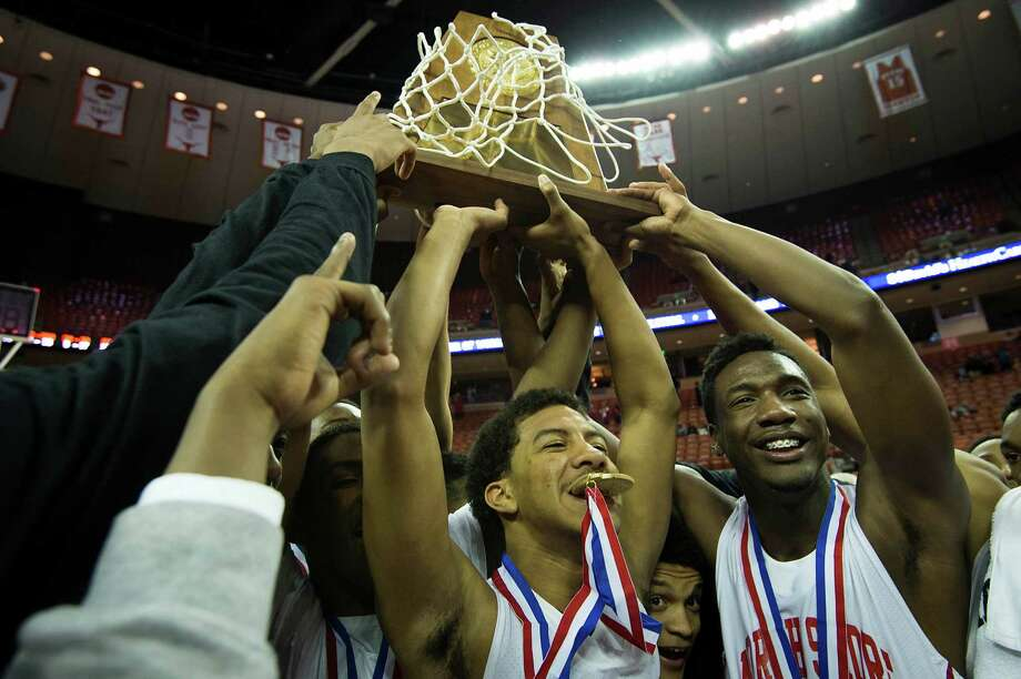 North Shore 57, Converse Judson 45Galena Park North Shore players, including guard Marion Roy, center, celebrate with their state championship trophy after defeating Converse Judson in the boys' UIL Class 5A state basketball championship game on Saturday, March 8, 2014, in Austin. Photo: Smiley N. Pool, Houston Chronicle / © 2014  Houston Chronicle