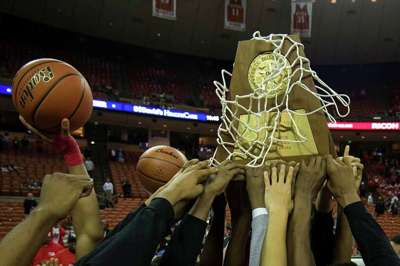 North Shore players celebrate with their state championship trophy after defeating Converse Judson.