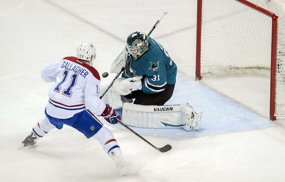 The Sharks' Antti Niemi stops a second-period shot by Canadiens right wing Brendan Gallagher - one of Niemi's 27 saves in the 4-0 shutout. Photo: Ed Szczepanski, Reuters
