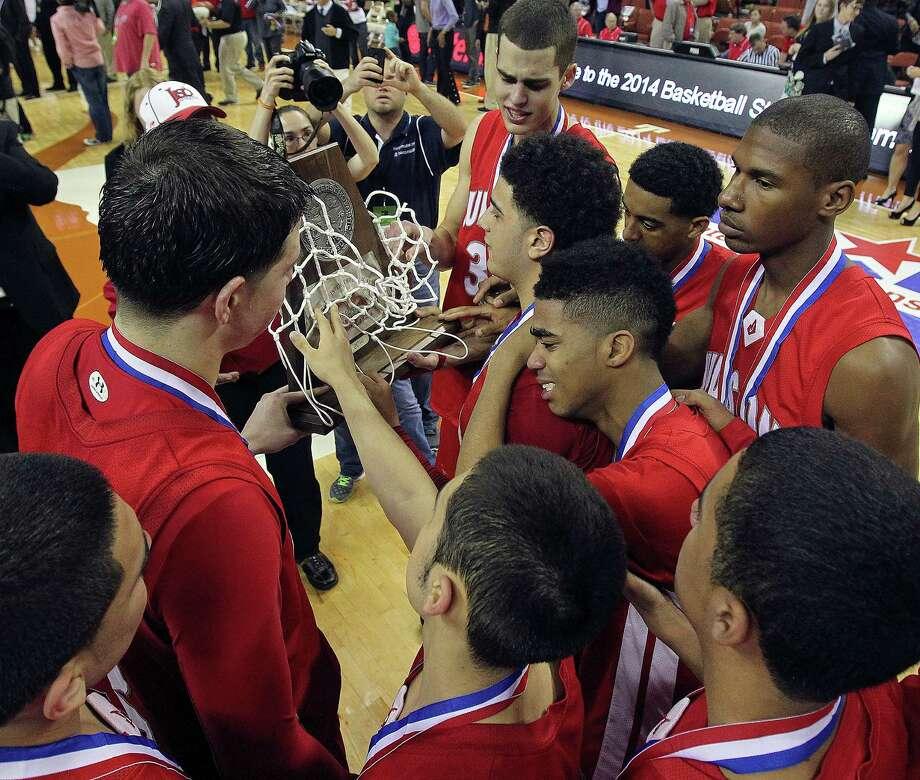 The Rockets gather around their second place trophy after losing 57-45 to Galena Park North Shore for the state 5A basketball championship at the Erwin Center in Austin on March 8, 2014. Photo: For The San Antonio Express-News