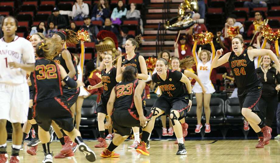 Mar 8, 2014; Seattle, WA, USA; The USC Trojans celebrate after defeating the Stanford Cardinal at Key Arena. Southern California defeated Stanford 72-68. Mandatory Credit: Steven Bisig-USA TODAY Sports Photo: Steven Bisig, Reuters