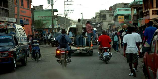 Traffic is a constant in downtown Cap-Haitien in December 2009. Photo: Christian Abraham / Connecticut Post