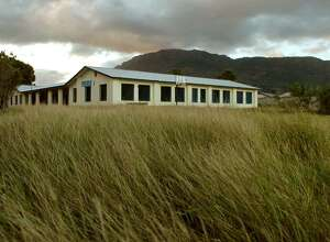 A view of a the main building inside The Village, the residential and school center of Project Pierre Toussaint, in the suburbs of Cap-Haitien.The Village is one of three compounds that made up Project Pierre Toussaint, a program designed to give a future to boys with none, now closed and patrolled by armed security guards 24 hours a day to keep out vandals.