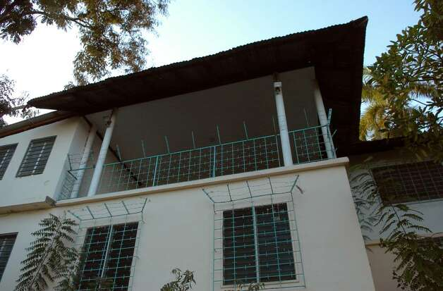 A view of the former residence of Douglas Perlitz, who was the executive director of Project Pierre Toussaint, in Cap-Haitien. Oblates of Mary Immaculate, a Roman Catholic missionary group founded in France, became so impressed with Perlitz's work, that they rented him this two-story house in Bel Air  for $6,000 a year with a stipulation that he build a $13,000 fence around the property to keep out homesteaders vandals and trespassers. Photo: Christian Abraham / Connecticut Post
