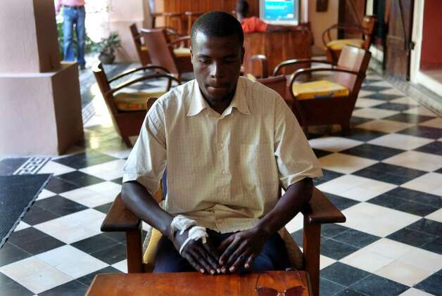 Wendy believes the allegations are false, and he is surprised the Haitian National police never interviewed him. He says meeting Douglas Perlitz on Haiti's dirty, dangerous streets and getting into The Village changed his life. At The Village, he learned responsibility by performing chores and completing homework, and he learned to read and write. Wendy was photographed at Hotel Roi du Christophe in downtown Cap-Haitien on Dec. 19, 2009. Photo: Christian Abraham / Connecticut Post