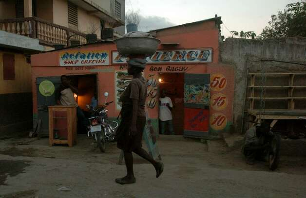A woman walks through the streets of downtown Cap-Haitien in December 2009. Photo: Christian Abraham / Connecticut Post