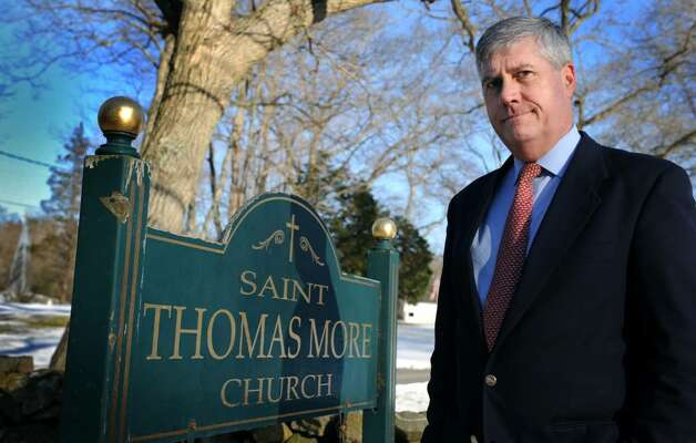 Michael Nowacki stands in front of St. Thomas More Church in Darien Friday Jan. 29, 2010. Nowacki, a  former parishoner at St. Thomas More Church in Darien, was nearly arrested for speaking out in the church and then leafletting parishoner's cars. He accuses St. Thomas More of failing to make a full disclosure of the Rev. Paul Carrier's involvement with the church as well as the whereabouts of $4,300 he said the Jesuit collected for his Haiti program. Photo: Autumn Driscoll / Connecticut Post