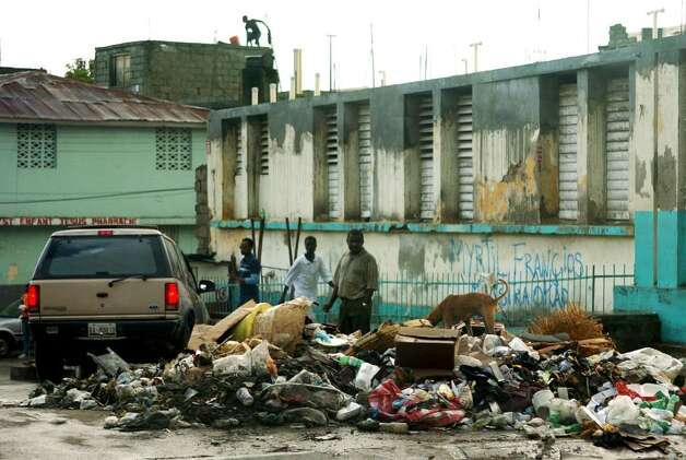 The city of Cap-Haitien, where many of its 180,000 residents pack the streets during daylight; where unemployment is the norm, where children beg for food, clothes and money and where garbage piles up in the streets. Photo: Christian Abraham / Connecticut Post