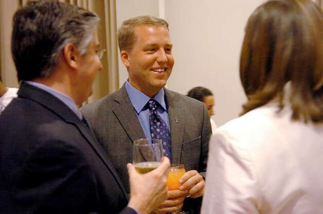 "Douglas Perlitz, Executive Director of Project Toussaint in Haiti, talks with guests at the ""Jazz it up for Haiti ""  benefit event at Fairfield University in March 2006. Photo: File Photo/Johnathon Henninger / Connecticut Post File Photo"