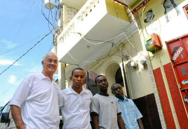 Rev. Paul Carrier, left, with some of the young men from Project Pierre Toussaint, a program in Cap-Haitien designed to give a future to boys with none. Photo: Contributed Photo / Connecticut Post Contributed