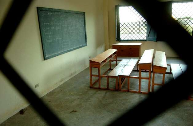 A classroom at The Village in the suburbs of Cap-Haitien is empty, yet a lesson plan remains on the chalkboard. The Village is one of three compounds that made up Project Pierre Toussaint, a program designed to give a future to boys with none, now closed and patrolled by armed security guards 24 hours a day to keep out vandals. Photo: Christian Abraham / Connecticut Post