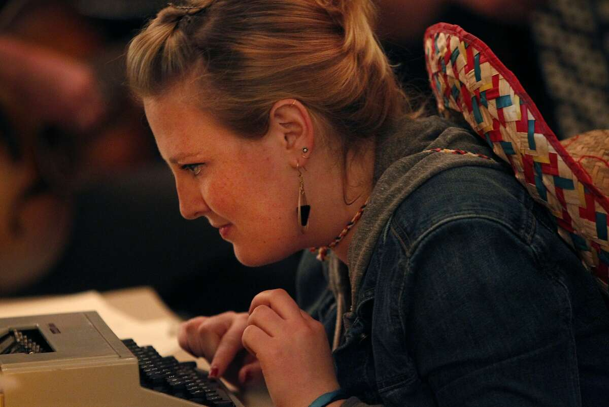Melanie Rubin, 23, types notes to friends with a typewriter during Unplug SF March 7, 2014 at Broadway Studios in North Beach in San Francisco, Calif. The event, which required all attendants to surrender their cellphones and all