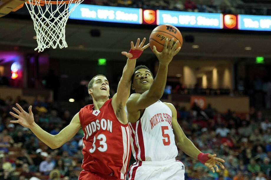 North Shore guard Brandon Green (5) puts up a shot past Converse Judson forward David Wacker. Photo: Smiley N. Pool, Houston Chronicle / © 2014  Houston Chronicle