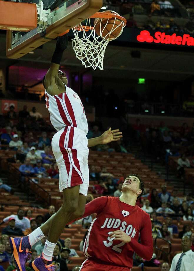 North Shore guard Kerwin Roach (23) dunks the ball past Converse Judson forward Tanner Leissne. Photo: Smiley N. Pool, Houston Chronicle / © 2014  Houston Chronicle
