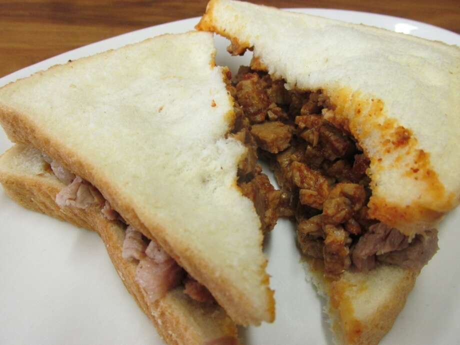 The chopped beef sandwich at Gerard's Barbecue Diner in Beaumont comes on white bread, not a bun. Simple. Photo: Cat5