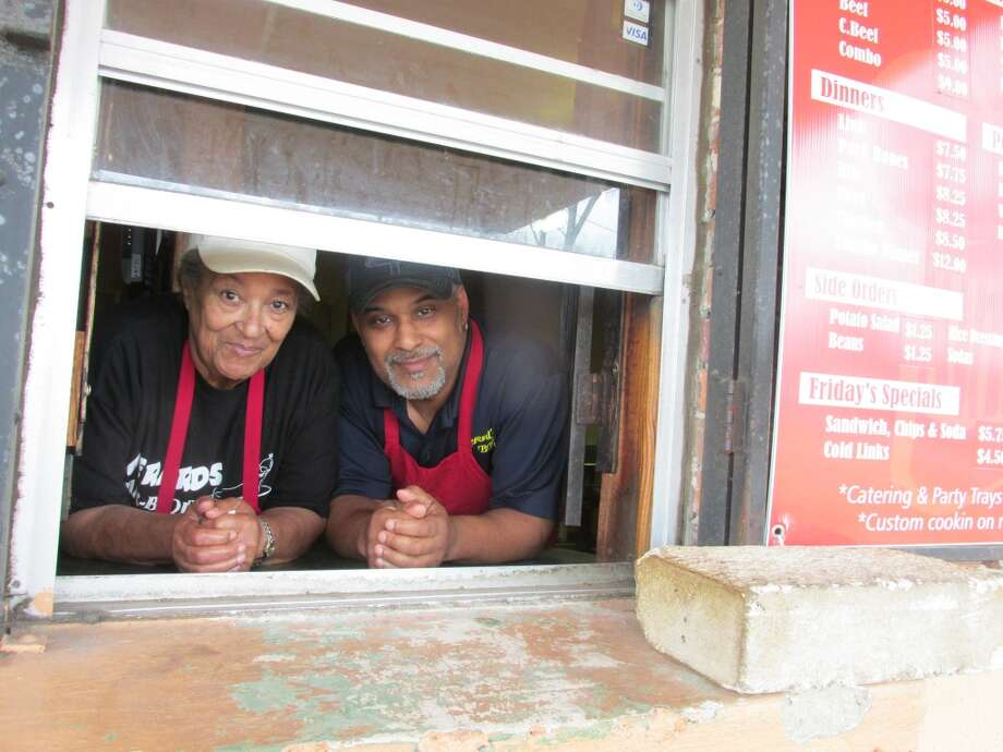 George Gerard and his mother, Marie, at the drive-thru window of Gerard's Barbeque Diner in Beaumont. Photo: Cat5