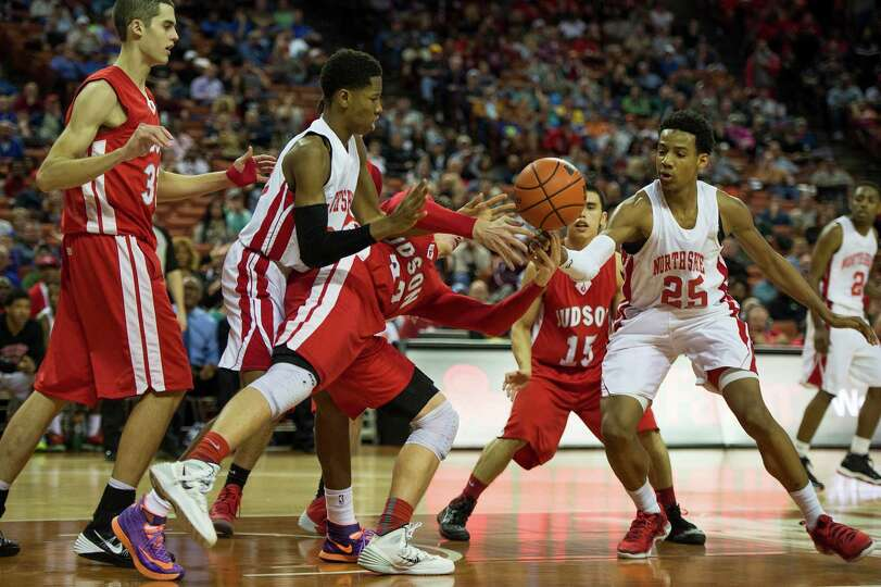 North Shore's Kerwin Roach (23) and Jarrey Foster (25) defend against Converse Judson forward Tanner