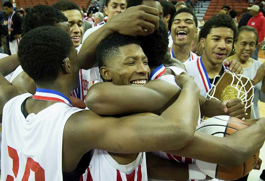 North Shore players celebrate with their state championship trophy after defeating Converse Judson. Photo: Smiley N. Pool, Houston Chronicle / © 2014  Houston Chronicle