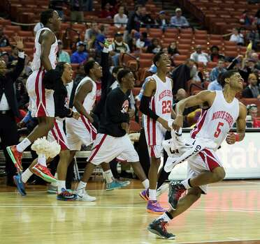 North Shore players, including guard Brandon Green (5) and guard Kerwin Roach (23) race onto the court after defeating Converse Judson. Photo: Smiley N. Pool, Houston Chronicle / © 2014  Houston Chronicle