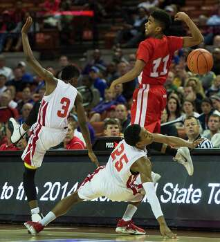 North Shore's Jarrey Foster (25) and Jalin Hart (3) knock the ball away from Converse Judson guard Rayshon Winn (11). Photo: Smiley N. Pool, Houston Chronicle / © 2014  Houston Chronicle