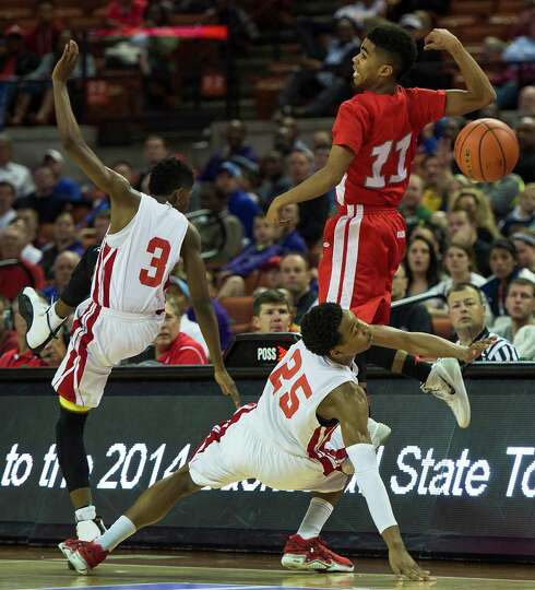 North Shore's Jarrey Foster (25) and Jalin Hart (3) knock the ball away from Converse Judson guard R