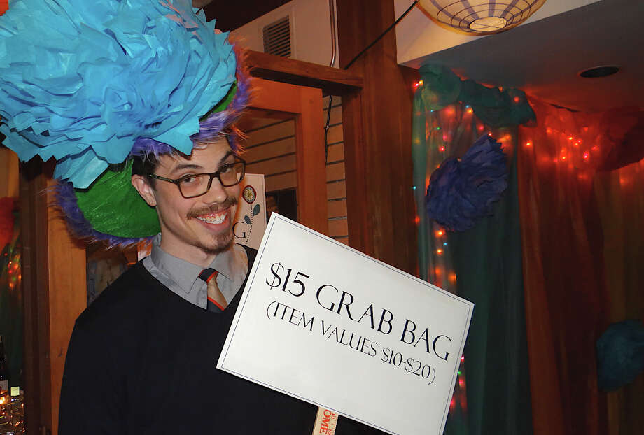 Andy Todd promotes a $15 grab bag at Earthplace in Bloom. Photo: Mike Lauterborn / Westport News