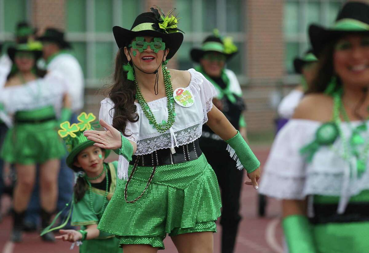 Marta Garcia of Kazamba de San Antonio dances in the St. Patrick's Day Parade at the University of the Incarnate Word on Saturday, Mar. 8, 2014.