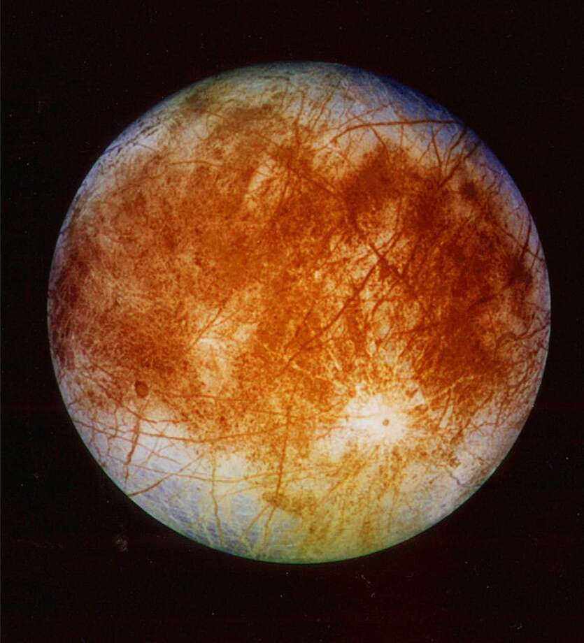 This image released by NASA's Jet Propulsion Laboratory in Pasadena, Calif. on Nov. 12, 1996 shows Jupiter's ice-covered moon, Europa, from the Galileo spacecraft. NASA said Tuesday, March 4, 2014 it is making preparations to plan a robotic mission to Jupiter's watery moon Europa, a place where astronomers speculate there might be life. The space agency set aside $15 million in its 2015 budget proposal to start planning a mission to Europa. No details were released but NASA chief financial officer Elizabeth Robinson said Tuesday that it would be launched in the mid-2020s. Photo: Uncredited, AP / A1997