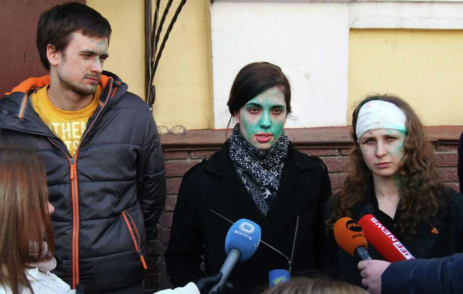 From right, members of the Pussy Riot punk group, Maria Alekhina, Nadezhda Tolokonnikova and her husband Pyotr Verzilov, with traces of antiseptic on their faces, speak to the media in Nizhny Novgorod, Russia, Thursday, March 6, 2014. Unidentified thugs assailed Tolokonnikova and Alekhina and doused them with antiseptic when they attempted to enter a prison in Nivzhny Novgorod. Tolokonnikova and Alekhina have vowed to protect prisoners rights. Photo: Roman Ignatiev, AP / AP2014