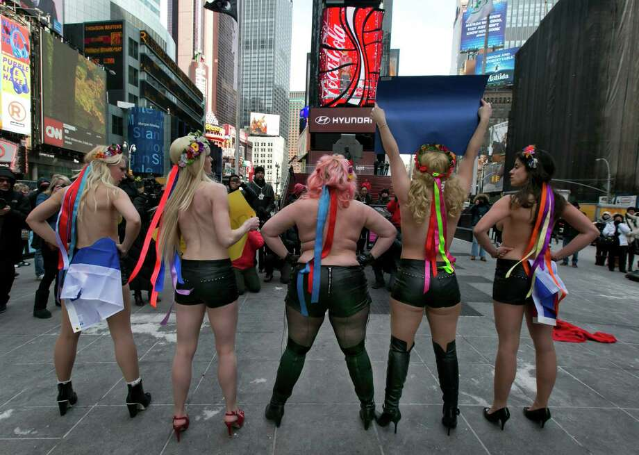 Female activist members of FEMEN go topless during their anti-Putin, pro-Ukraine demonstration in New York's Times Square, Thursday, March 6, 2014. Photo: Richard Drew, AP / AP2014