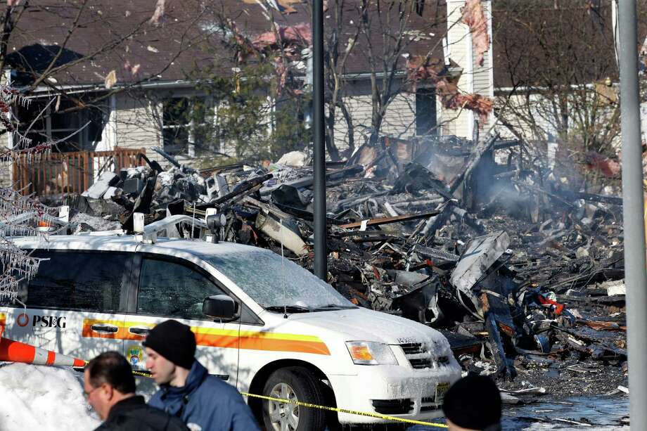 This Wednesday, March, 5, 2014 photo shows debris and damage from the previous day's explosion at a townhouse complex in Ewing, N.J. Investigators are looking to determine what triggered a natural gas leak and explosion that devastated the development, killing one woman and injuring seven workers. Photo: Mel Evans, AP / AP2014