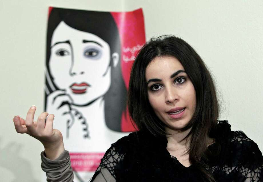 """In this Wednesday, Feb. 26, 2014 photo, Maya al-Ammar, an official with the Lebanese women's rights group Kafa, Arabic for """"Enough,"""" speaks during an interview with The Associated Press in her office, in Beirut, Lebanon. Although Lebanon appears very progressive on women rights compared to other countries in the Middle East, domestic violence remains an unspoken problem and the nation's parliament has yet to vote on a bill protecting women's rights nearly three years after it was approved by the Cabinet. On Saturday, March 8, 2014 about 5,000 people marched in Beirut to demand protection for women and urged the parliament to vote on the domestic violence law. Photo: Bilal Hussein, AP / AP"""