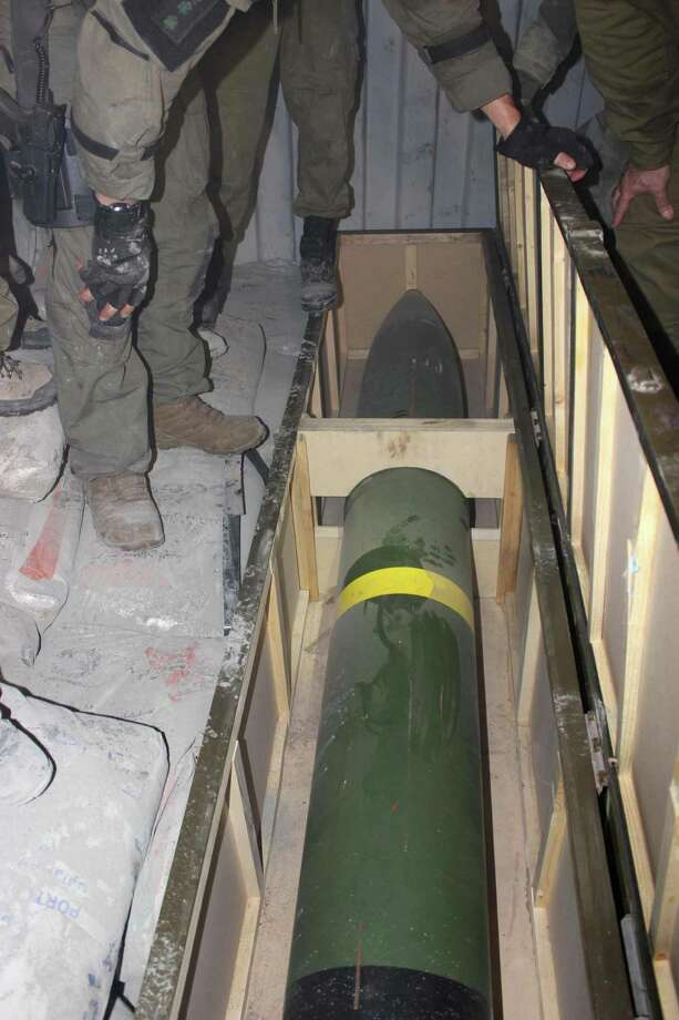 This photo released by the Israel Defense Forces shows a missile on an intercepted ship in the Red Sea Wednesday, March 5, 2014. Israeli naval forces raided a ship deep in the Red Sea early Wednesday and seized dozens of advanced rockets from Iran destined for Palestinian militants in Gaza, the military said. Photo: Uncredited, AP / AP2014
