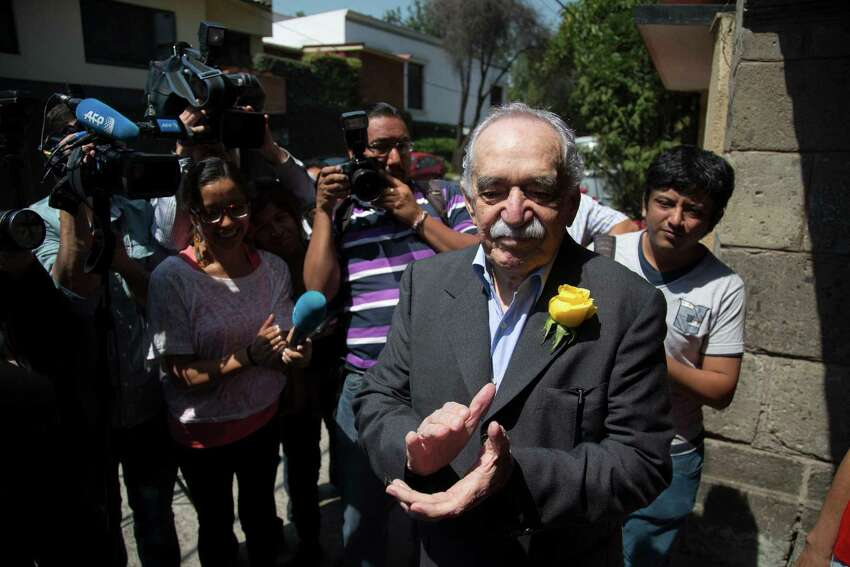 Colombian Nobel Literature laureate Gabriel Garcia Marquez applauds with fans and reporters outside his home on his birthday in Mexico City, Thursday, March 6, 2014. Garcia Marquez, known as