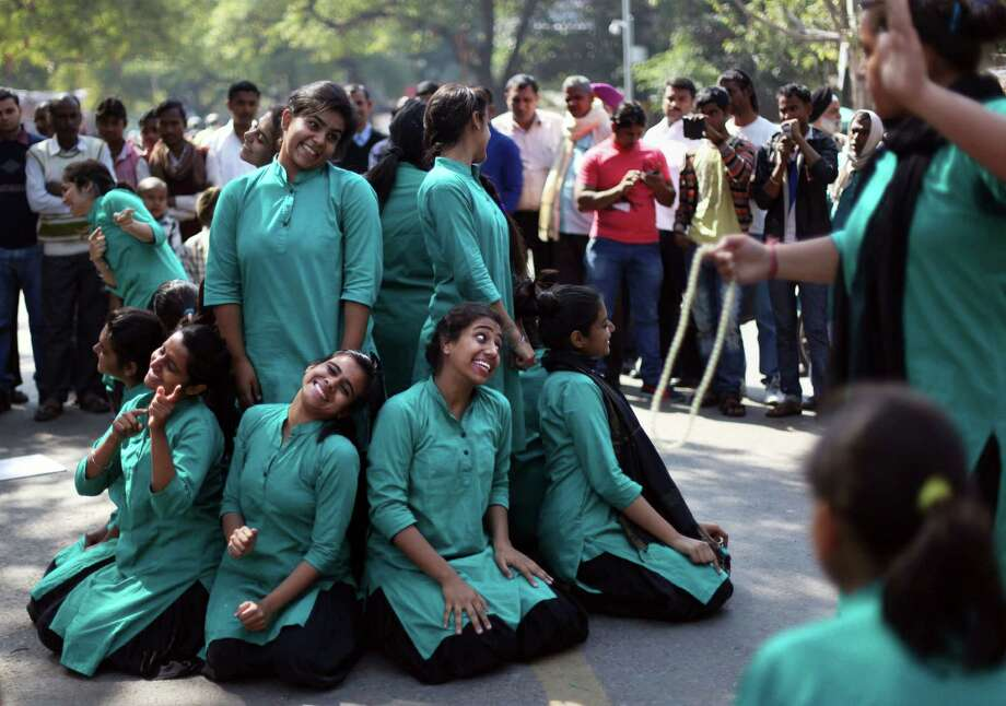 A group of college girls perform a street play on violence against women, to mark International Women's Day in New Delhi, India, Saturday, March 8, 2014. Photo: Tsering Topgyal, AP / AP2014