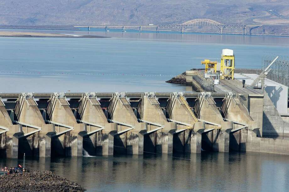 On Monday, March 3, 2014 near Vantage, Wash., the Wanapum Dam spillway support, fourth support from the right, is seen, which has a large crack beneath the water surface that was discovered last week. Columbia River water levels have been lowered up to 20 feet on the upstream side of the dam, in order to relieve stress on the dam. Photo: Don Seabrook, AP / The Wenatchee World