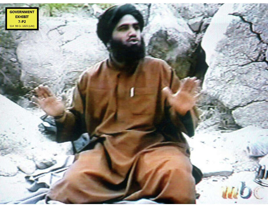 In this undated Photo taken from video and provided by the United States Attorney's Office for the Southern District of New York, defendant Suliman Abu Ghayth, sits on the ground somewhere in Afghanistan. Abu Ghayth, is being tried in New York for plotting to kill Americans by being a motivational speaker at al-Qaida training camps before the Sept. 11 attacks and for serving as a spokesman for the terror group afterward. This photo was among the trial exhibits that the federal prosecutor showed the jury, sometimes repeatedly. Photo: Uncredited, AP / AP2014