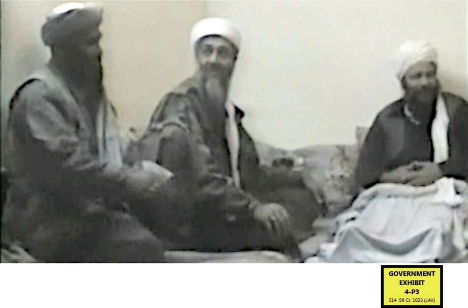 In this undated photo provided by the United States Attorney's Office for the Southern District of New York, defendant Suliman Abu Ghayth, left, joins al-Qaida founder Osama Bin Laden, center, and an unidentified man somewhere in Afghanistan. Abu Ghayth, Osama Bin Laden's son-in-law, is being tried in New York for his role as a recruiter and motivational speaker for the terror group. Photo: Uncredited, AP / AP2014