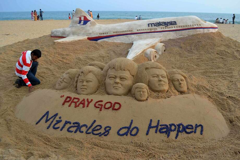 Indian sand artist Sudarshan Patnaik applies the final touches to a sand art sculpture he created wishing for the well being of the passengers of Malaysian Airlines flight MH370, on a beach in Puri, in the eastern Indian state of Odisha, March 9, 2014. The Malaysia Airlines flight carrying 227 passengers and 12 crew went missing in area near the South China Sea on Saturday as it flew from Kuala Lumpur to Beijing and was presumed to have crashed. REUTERS/Stringer (INDIA - Tags: DISASTER TRANSPORT TPX IMAGES OF THE DAY SOCIETY) Photo: Stringer/india, Reuters
